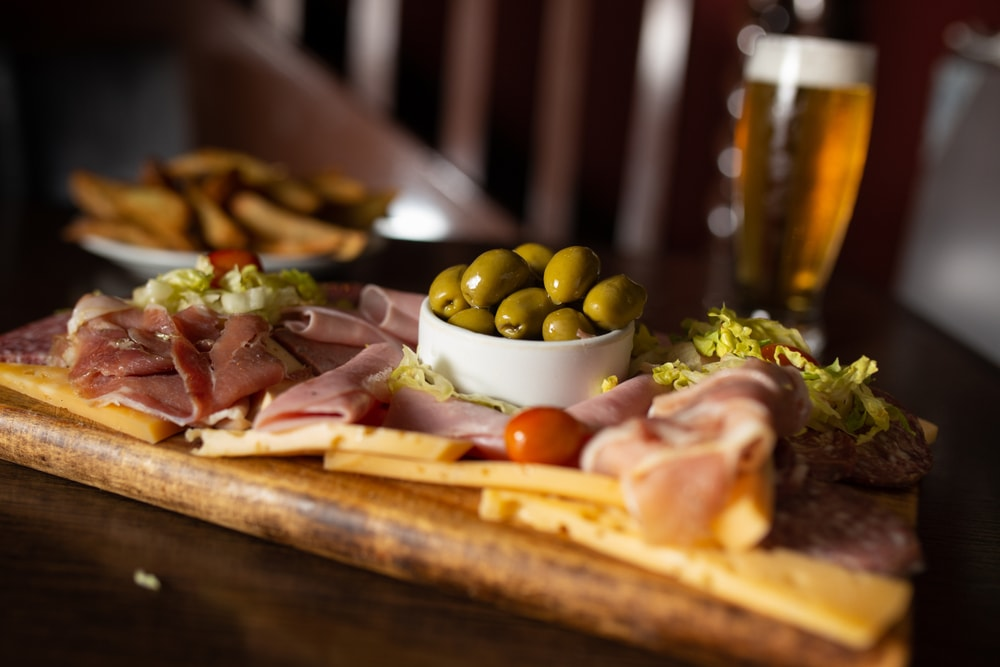 cheese board with meats and olives